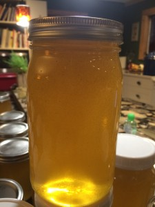Look at this beautiful jar of raw honey, with all the little specs of light and dark pollen suspended in the honey